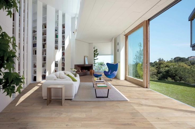 This modern livingroom has a light toned wood look porcelain tile called Cream. There are other colors available.
