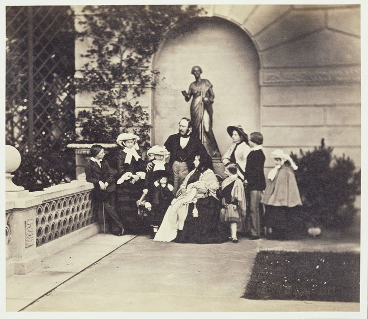 Photograph of Queen Victoria and Prince Albert with their nine children, taken at Osborne on 26 May 1857. Osborne House was very much a private family home, purchased by the Royal couple in 1845.| From left to right: Prince Alfred, Princess Alice, Princess Helena, Prince Leopold, Prince Albert, Queen Victoria holding Princess Beatrice, Prince Arthur, Victoria, Princess Royal, Albert Edward, Prince of Wales and Princess Louise.