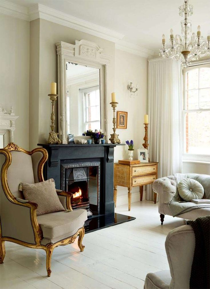 Transforming a Victorian maisonette | Period Living - a beautifully decorated living room! Love the black fireplace and mirror.