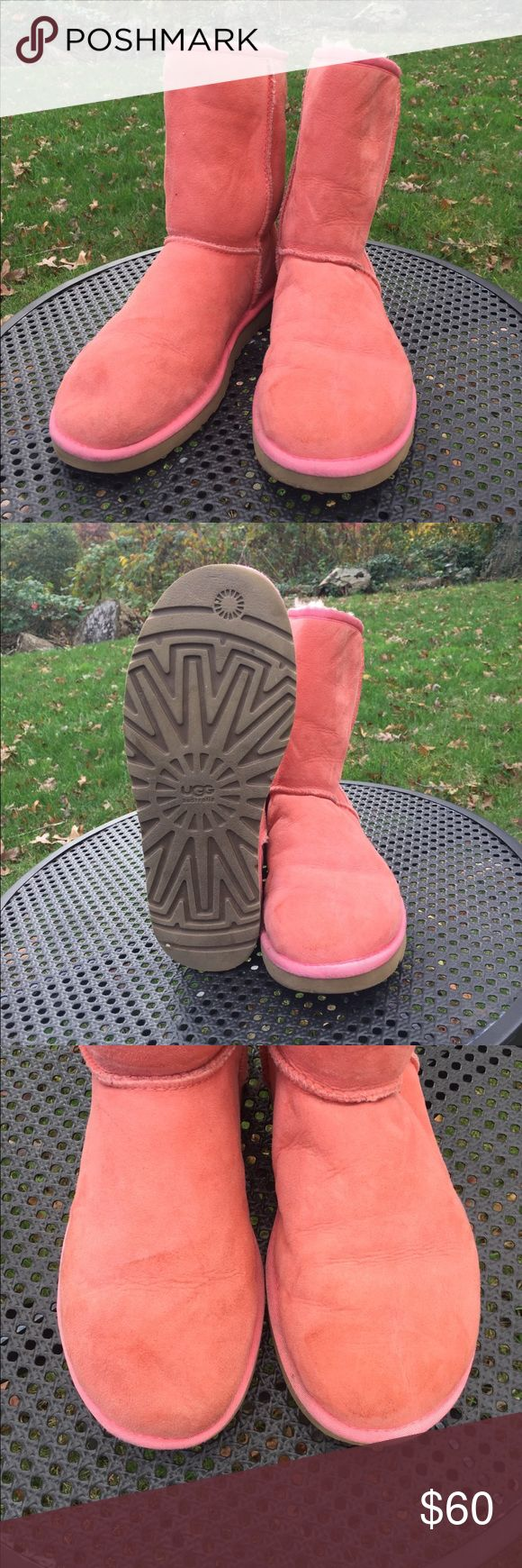 Bright and Warm Salmon Uggs These fun and bright salmon hugs will keep your feet cozy all winter long. The color makes them impossible to miss and you'll surely get tons of compliments on the unique hue. Size women's 9 but could fit 9, 9.5, and 10. Soles are in excellent condition and surface area of shoes have slight discoloration near the top as shown in pictures. I believe ugg or leather cleaner should be able to clear this up. But wear will be factored into price. Fold over, or tuck…