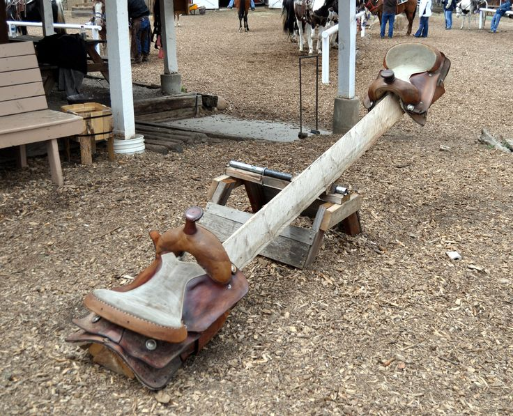 A saddle see-saw! Why did I never have this?! Seriously though... Why?