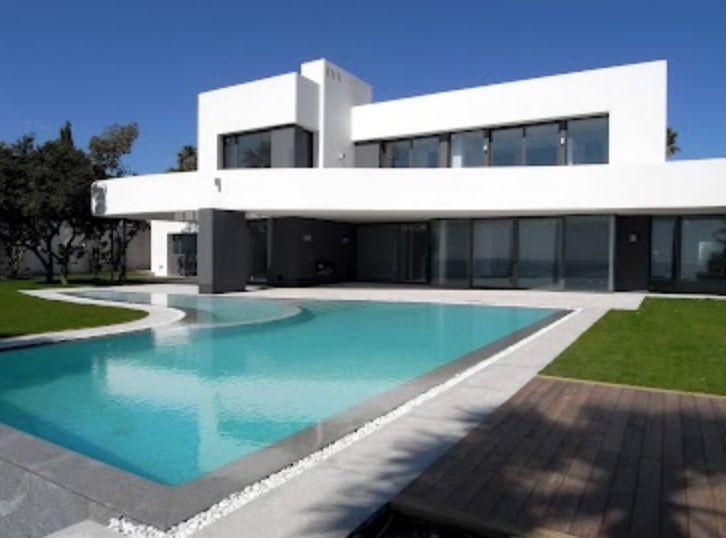 Modern white villa with direct beach access, Marbella, Spain