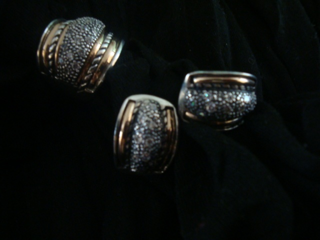 Material: silver, gold and zircon