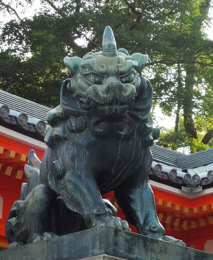 Komainu  often called lion-dogs in English, are statue pairs of lion-like creatures either guarding the entrance or the inner shrine of many Japanese Shinto shrines or kept inside the inner shrine itself, where they are not visible to the public. The first type, born during the Edo period, is called sandō komainu , the second and much older type jinnai komainu. They can sometimes be found also at Buddhist temples, nobility residences or even private homes.
