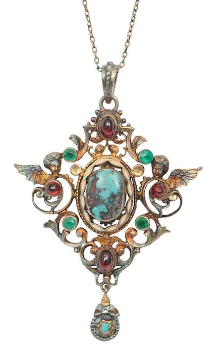 A pendant with putto ornament in renaissance-style German, end 19th cent. Silver, marked 835, gilded. In the center with ovale turquoise in enamel frame, with red and green coloured stones and with putto head. Silver necklae l. 44 cm, pendant 74 x 51 cm