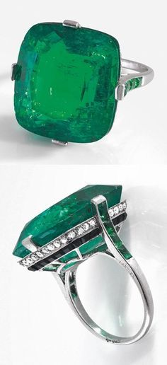 CARTIER - An Art Deco platinum, emerald, diamond and onyx ring, circa 1930. Set to the centre with a cushion-cut emerald weighing 27.82 carats, the gallery set with onyx and diamonds, and the shoulders set with a line of calibré emeralds. Signed. #Cartier #ArtDeco