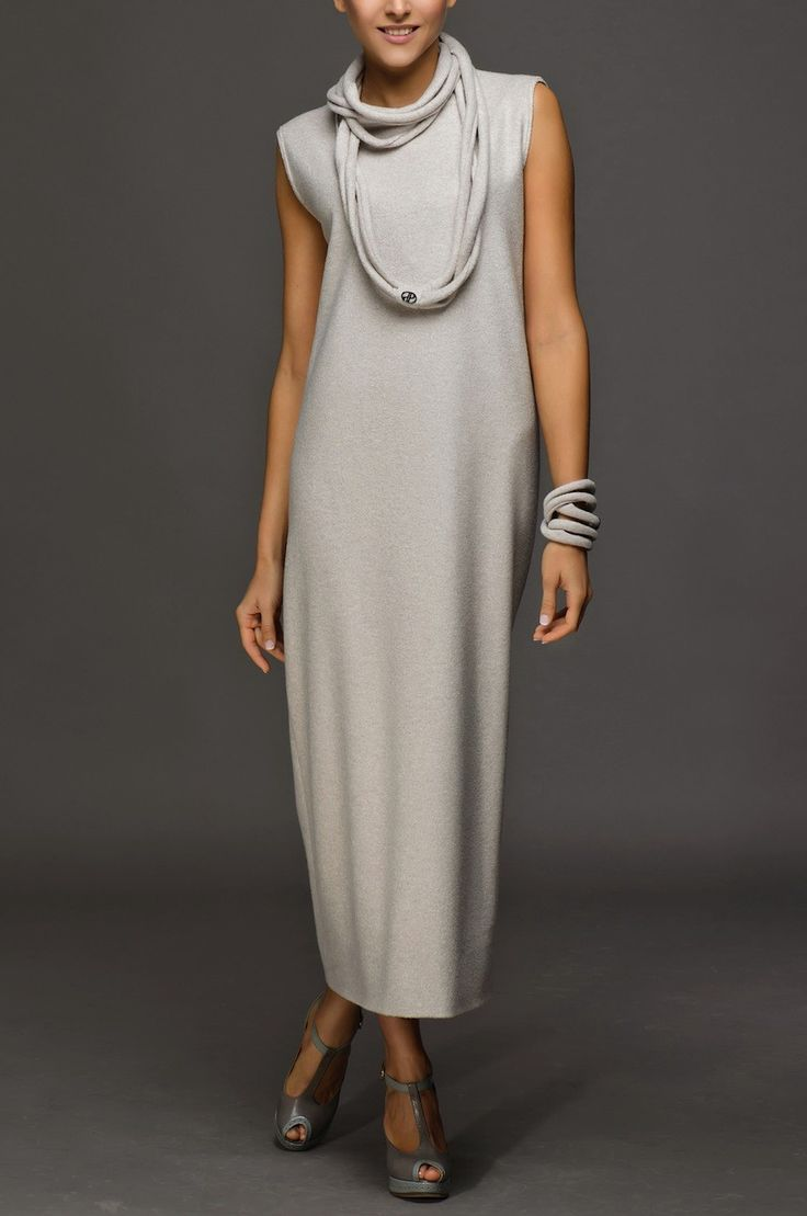 """Grand light-gray long woolen dress. Informal midi is in the wardrobe of fashionable women the world over in this season. Simple style of dress also says that this is """"must have"""" thing in 2015. This model is for those who prefer comfort and elegance. Necklace and a bracelet go as one assembly with the dress."""