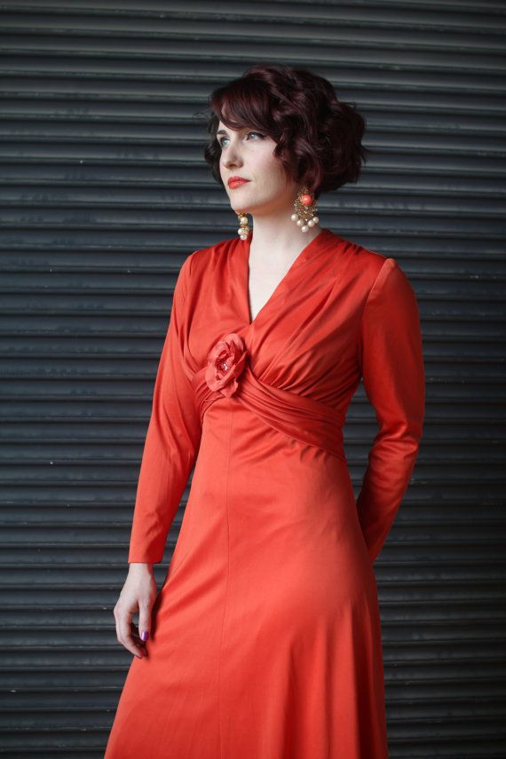 Vintage jersey hostess dress with rosette in tomato red, 1970s