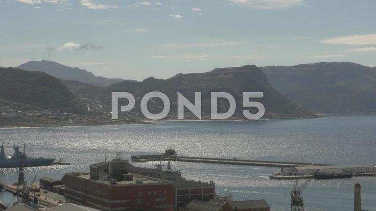 4k Beautiful Blue Water Ocean View Mountains In Background Pier Naval Dockyard - Stock Footage   by RyanJonesFilms