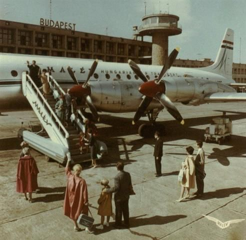 Budapest Ferihegy, 1960s. Boarding a Malev flight on an old Russian Ilyushin il-18 passenger airliner.