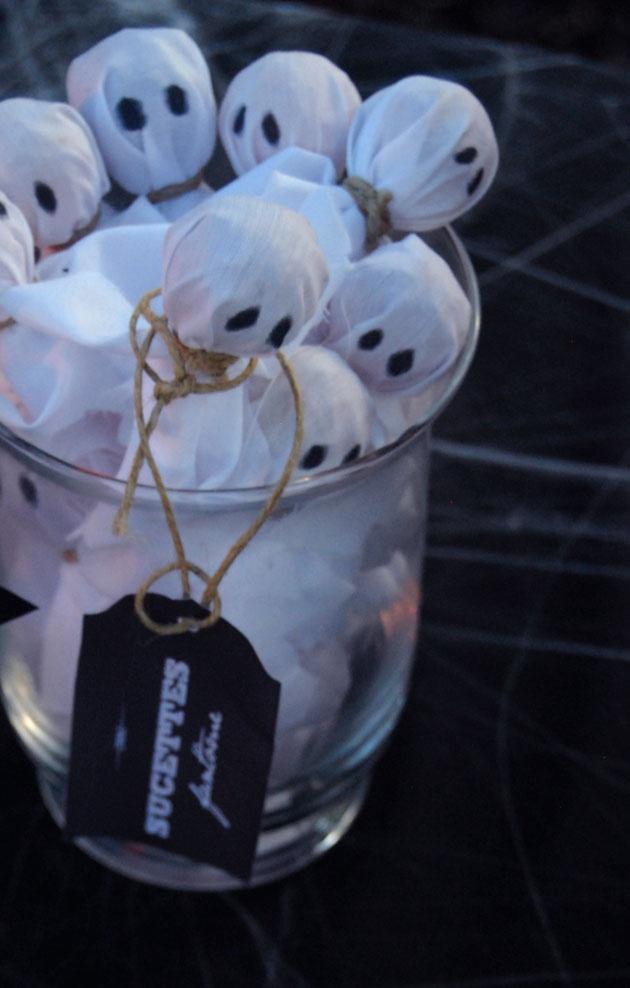 Halloween treat idea. Ghost suckers with mini nooses around their necks.