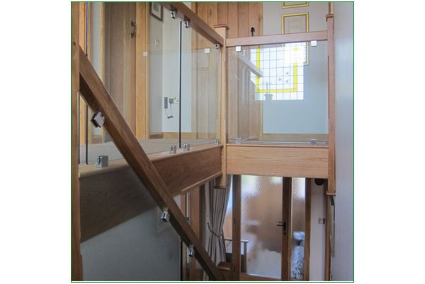 The Beehive Staircase - This American white oak staircase has been designed to allow the light from the stained glass window to flow down the stairs and around the gallery balustrade.