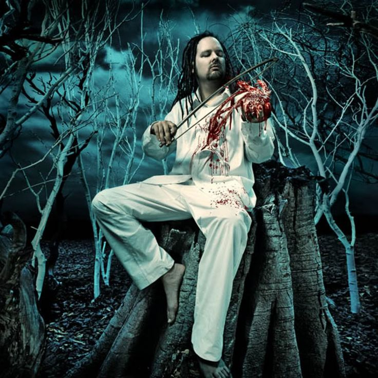 analysis of the music of the metal band korn and its frontman jonathan davis Part 9: 1998: you're either with korn and limp bizkit  and frontman jonathan davis' half-rapped  nü-metal band korn offers its listeners an earful of pain.