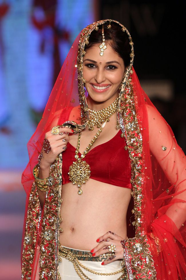 Pooja Chopra arrived dressed in a traditional lehenga choli depicting the Punjabi bride as she displayed more stunning jewellery by Swarovski at the Indian International Jewellery Week 2014. #Style #Bollywood #Fashion #Beauty #IIJW