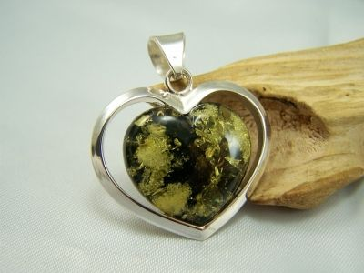 Lovely heart shaped green amber pendant with heart shaped silver mount.