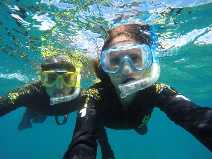 Find out the best ways to experience the Great Barrier Reef up close and personal. From deep sea dives to hot air ballon flights the options are endless.