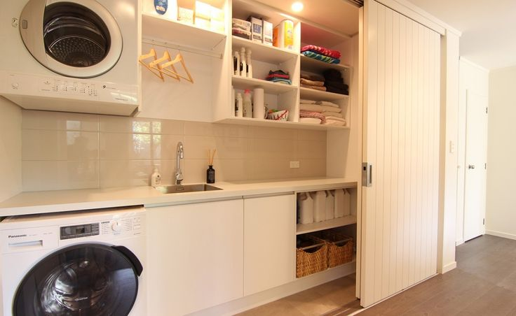 Renovated laundry room with sliding doors to hide space when not in use.