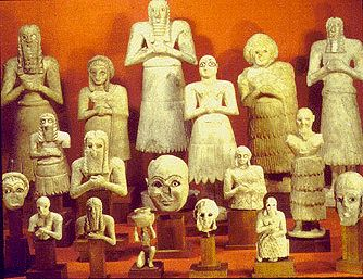 stone figures from tell asmar. 2700 BC. Figures range in size up to 30 inches. Poses of supplication indicate the religious nature of these figures. The hierarchy in size represents the hierarchy of the society that created them. Marble.