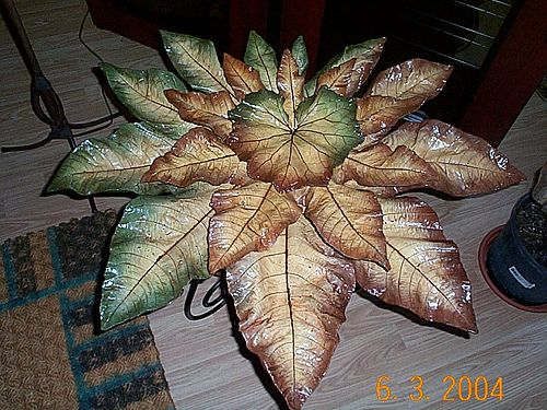 Concrete leaves. Large castor bean leaves stacked one on the other with a colts foot leaf at the top.