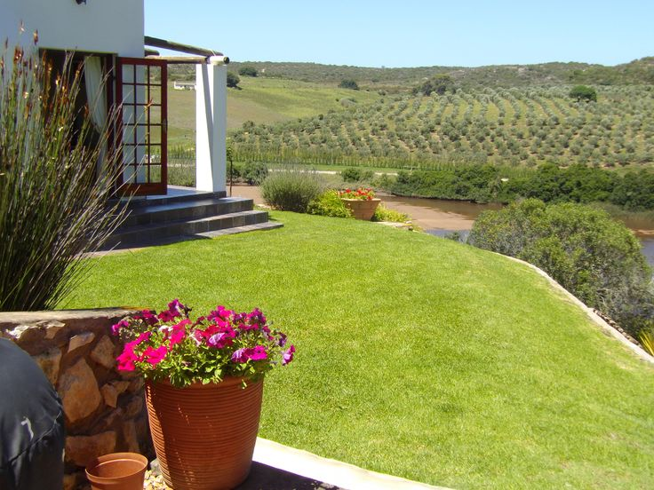 This beautiful property situated 9kms outside of Stilbaai at Riverside resort.  Make this your holiday home or primary residence.  Riverside is a well run resort with its own launch area and is popular with the ski-ing and boating fraternity.