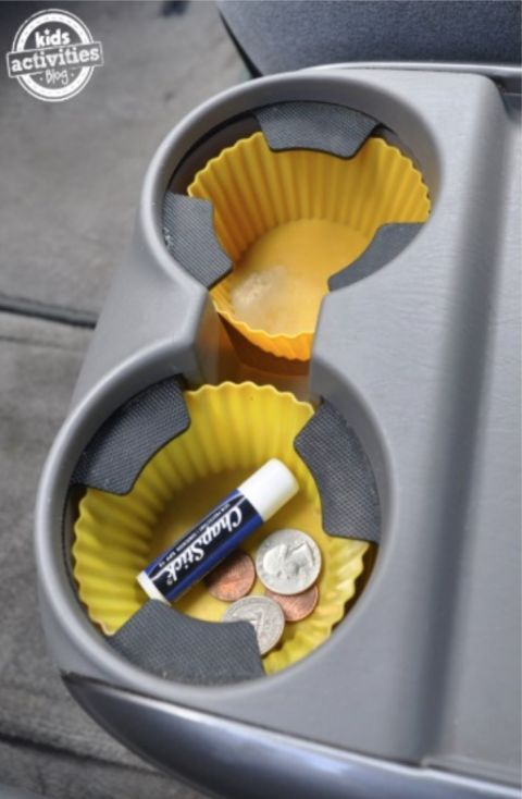 I'm sooo doing this next time I clean my car. Use silicone cupcake liners to keep your cup holders clean.