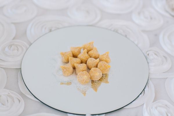 Put some creativity and thought in your reception food. Choose local desserts wherever you are and make an impression | Santorini wedding