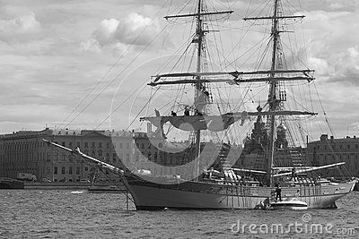 The crew of the brig Tre Kronor prepares his ship to the exit of the Neva river after the feast of Scarlet sails. Saint-Petersburg, Russia