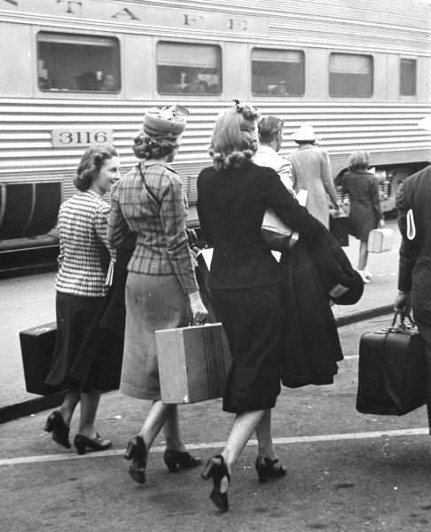 girls carrying their luggage at the train station, pasadena, ca, 1939 • peter stackpole (the station's still there)