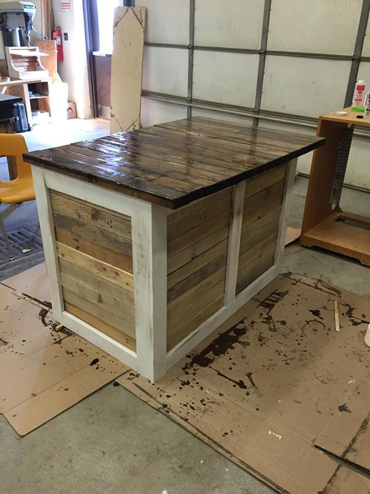 Kitchen island made from 2x4s and pallets check out the for Build kitchen island with cabinets