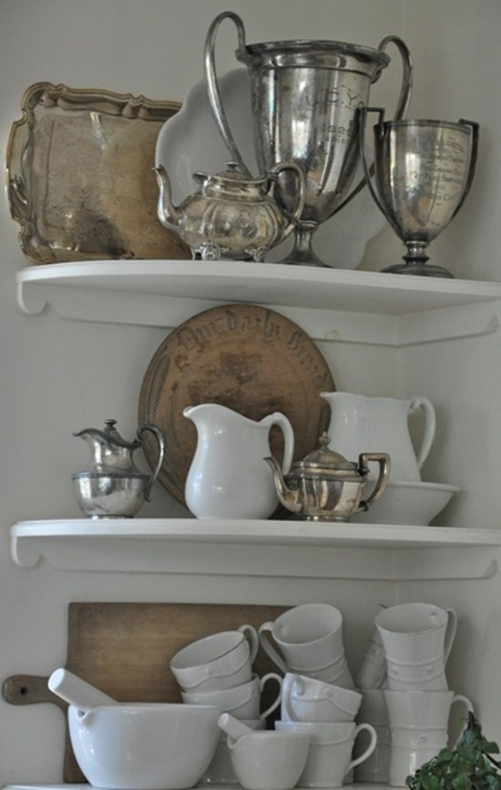 old silver. old bread boards. white dishes.