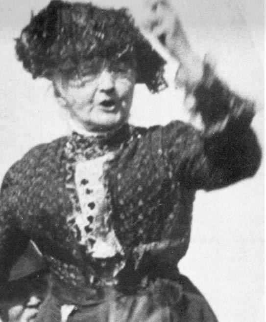 """September 30, 1899:  Mother Jones organizes the wives of striking miners in Arnot, Pennsylvania, to descend on the mine with brooms and mops and clanging pots and pans.  """"I told the men to stay home with the children for a change and let the women attend to the scabs.""""  The women frightened away the mules and their scab drivers and returned daily to keep watch.  The miners eventually won their strike."""