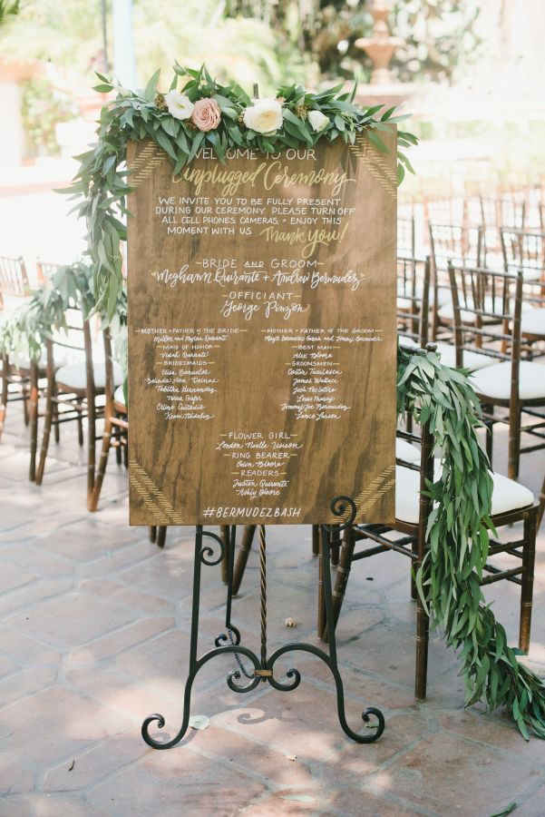 Wooden unplugged wedding sign: http://www.stylemepretty.com/little-black-book-blog/2016/11/30/blue-bohemian-summer-california-wedding/ Photography: One Love - http://www.onelove-photo.com/