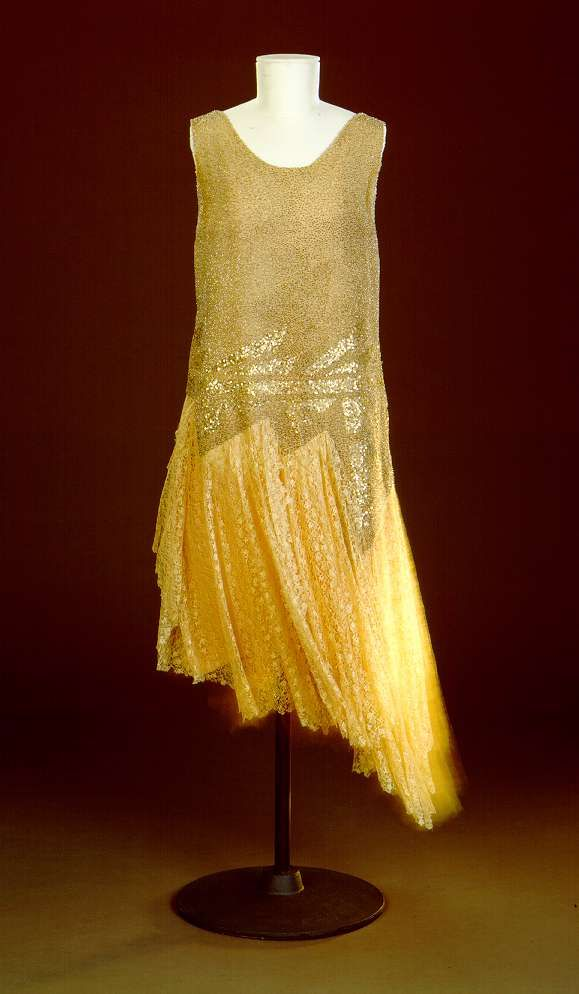 """Charleston"" Dress: ca. 1926, silk, beads, sequins. ""Part of the life style of the 'Golden Twenties' -- along with theaters, musicals, cabarets, and movies -- was dancing. The 'Charleston' became the most popular American dance in Germany, not least because of Josephine Baker, who in 1927 gave performances with her 'Charleston Jazzband' in Berlin. The necessary freedom of movement was guaranteed for the ""new woman"" by knee-length shirt-dresses, embroidered with glass beads and paillettes..."""