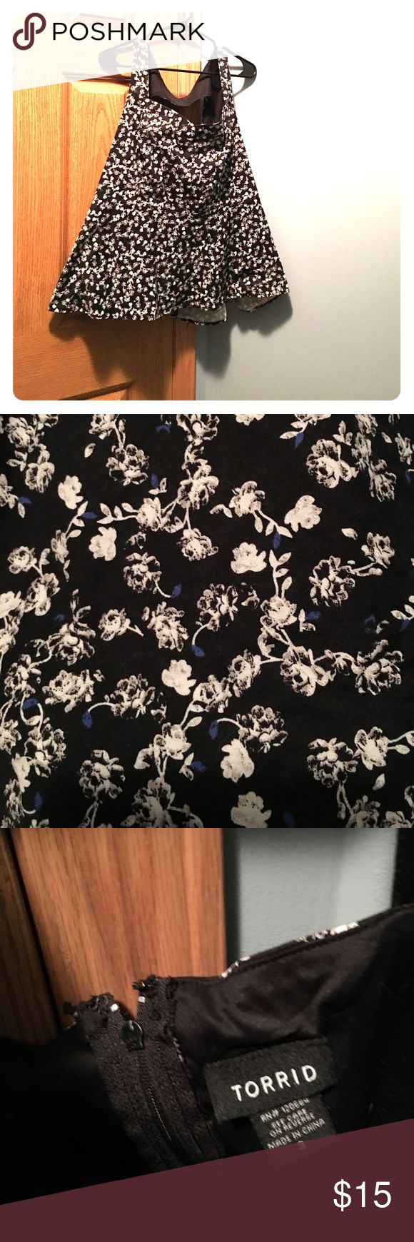 Torrid peplum style dress shirt Cute black peplum cut shirt with white flowers and specs of dark blue. Size 3. Last pic is of the back, cute cut out on upper half. torrid Tops