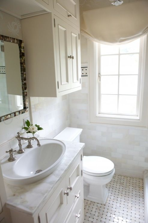Heather Garrett Design: Small elegant bathroom with marble basketweave  tiles floor, marble subway tiles