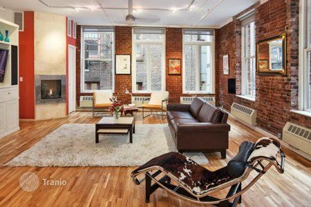 Classic loft in Manhattan - brick veneer walls, pipes and wires exposed on the show. Industrial elements softens wood, leather, textiles, chocolate and cream shades.