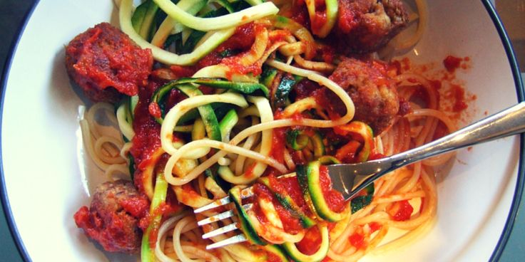 Crispy & delicious tuna meatballs are served atop noodles & 'zoodles' (courgette/zucchini noodles) with an easy homemade tomato sauce. Ready in 1 hour. YUM!