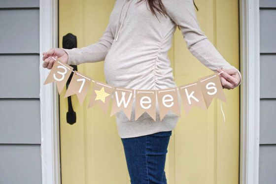 Cute! Take a weekly pregnancy photo to show how your belly grows over time. Hold a banner that shows how far along you are.