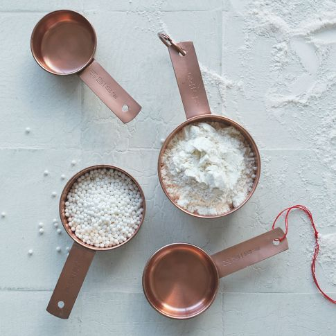 Copper Measuring Cups reminds me of the stainless steel ones I grew up with in my moms kitchen. I WANT these! :)