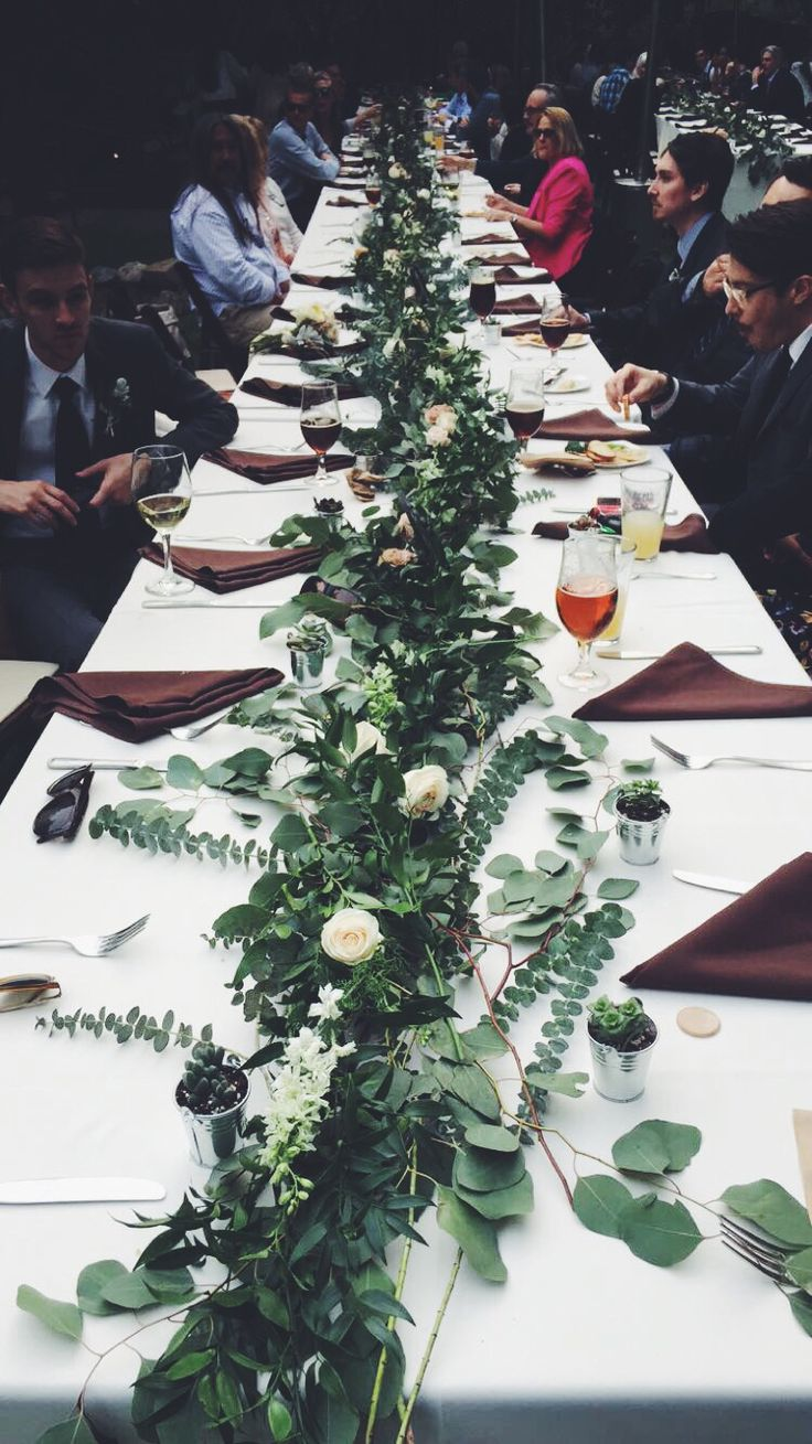 Long tables + greenery/flowers as center pieces. Eucalyptus!! Baby succulents as gifts!