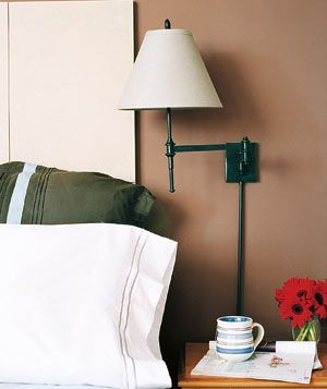 Good idea for our guest bedroom, where there isn't a lot of room for a bedside stand and lamp!
