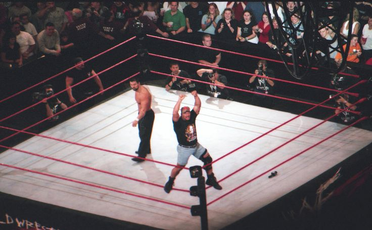 This #throwbackthursday is brought to you by John Huhn who earned the status of best father in the universe. The year was 2000 the event was a @wwe PPV Unforgiven. Twelve year old Travis didn't realize his friend selfishly ordered scattered seats. Two together and one single.  My Dad who had no interest in wrestling what so ever sat by himself in the last row of the stadium so we can attend.  Not only that but he rented a very expensive state of the art film camera so he could potentially…
