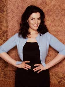 Another inspiration for me to draw on, Nigella Lawson, - note the cardigan over the dress and the not very revealing neckline but still kinda scooped, i could add a belt to that and work it!