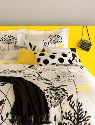 Anis Yellow Duvet Cover Set. The colorful yellow and black really pop.