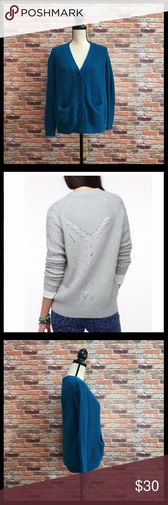 """Urban Outfitters Kimchi Blue Back Stitch Cardigan Urban Outfitters Kimchi Blue Backstitch Cardigan in a size small.  Has a deep v neck with five buttons down the front.  Back and shoulders have a cutout open knit design.  Two front pockets. Soft fuzzy sweater.  Measures approximately 19"""" armpit to armpit, and 24""""in length.  70% acrylic, and 30% wool.  In excellent condition. Urban Outfitters Sweaters Cardigans"""