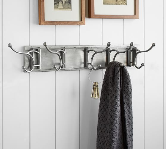 collapsable wall hooks from pottery barn these wall hooks fold flat when not in use