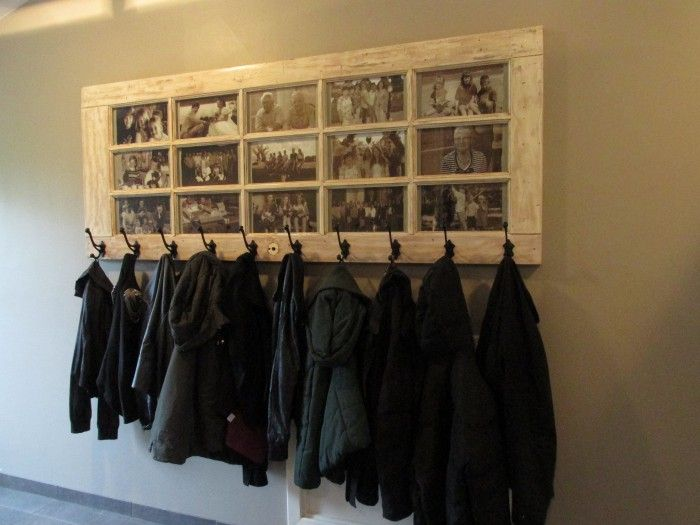 Make your own coat rack out of an old door. This one with the pics inside is awesome!
