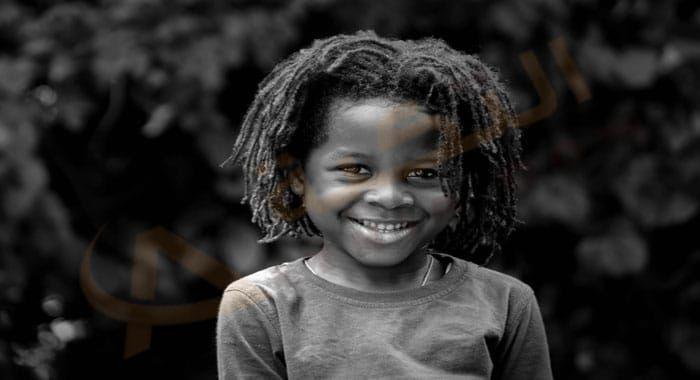 تفسير حلم رؤية الطفل الأسود في المنام معنى الطفل الأسود الرضيع في الحلم للعزباء والمتزوجة والحامل دلالات الطفل الأسود الضاحك Hair Styles Rasta Damaged Skin