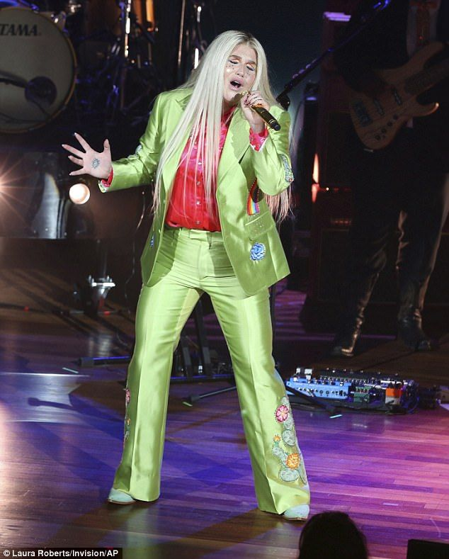 Neon dream:Kesha certainly proved her sartorial confidence as she stepped out to perform on the Nashville, Tennessee leg of her Rainbow Tour in a bright neon outfit