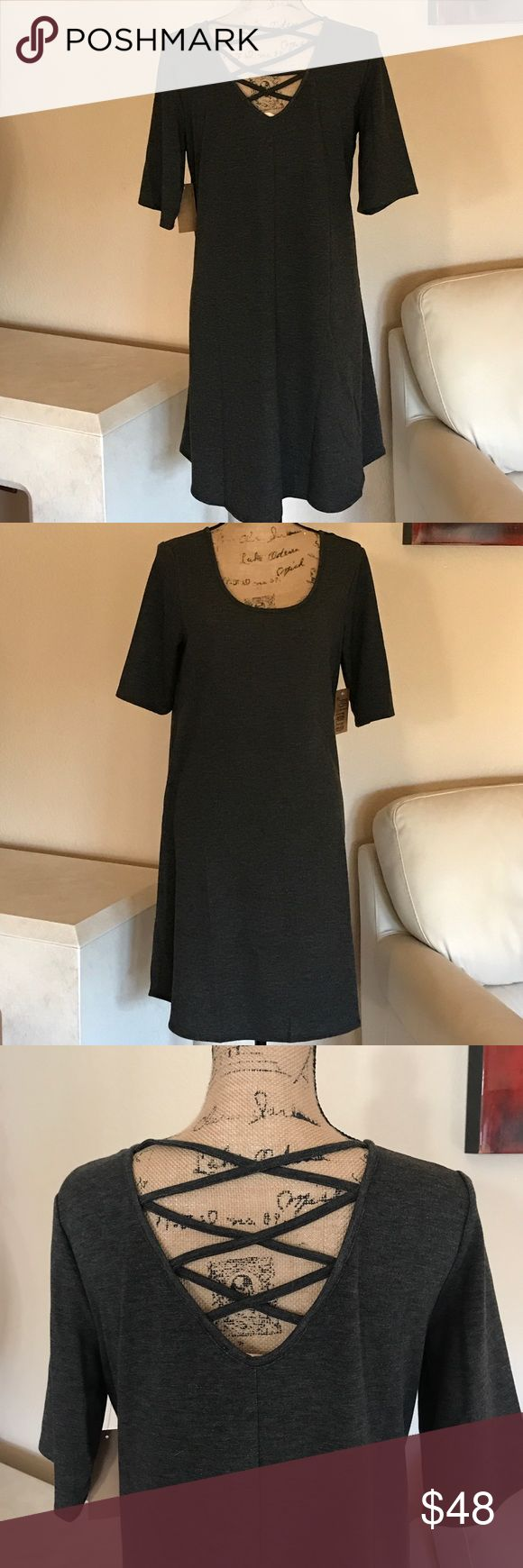 """""""JUST FOUND"""" the perfect Charcoal Grey Dress 1X This beautiful swing dress is 63% Rayon 32% Polyester 4% Spandex. It has the look and feel of a very lightweight Sweatshirt but it is light and must comfortable for fall. See the pic of what the material looks like on the inside of the dress. JUST FOUND Dresses"""